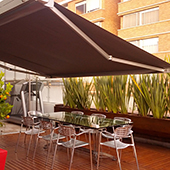 folding arm awning over outdoor dining area