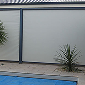 roller screens on veranda near pool