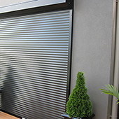 roller shutters on entrance to industrial building