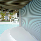 roller shutters on entrance to large swimming pool